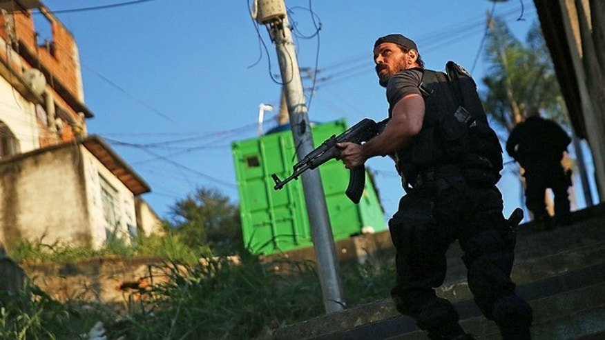 Special forces during an operation to search for fugitives in the Complexo do Alemao favela on May 13, 2014 in Rio.