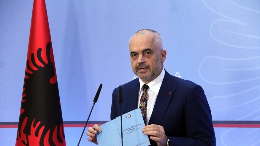 Albania's Prime Minister Edi Rama speaks at a news conference to confirm a compromise has been reached with the opposition on the judiciary reform package, in Tirana, Wednesday, July 20, 2016. International pressure has convinced Albania's main opposition Democratic Party to accept the final draft of a judicial reform package, considered fundamental to convincing the European Union to launch membership negotiations with the Balkan country. (AP Photo/Hektor Pustina)
