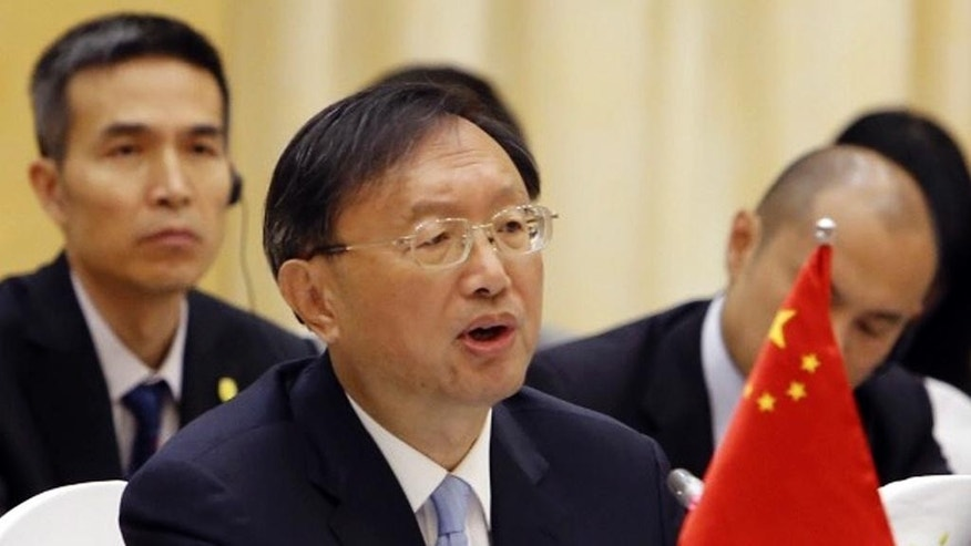 "FILE - In this June 27, 2016 file photo, Chinese State Councilor Yang Jiechi speaks during a cooperation conference with Vietnamese Foreign Minister Pham Binh Minh in Hanoi, Vietnam during his two-day visit to Vietnam to try to promote cooperation amid growing tension over Chinese growing assertiveness in the South China Sea. ""China is ready to discuss with countries concerned about provisional arrangements pending final settlement of the dispute,"" the country's top diplomat, Yang said last week. Yang did not describe specifics of the arrangements but said they would include joint development for ""mutual benefits."" (AP Photo/Tran Van Minh, File)"