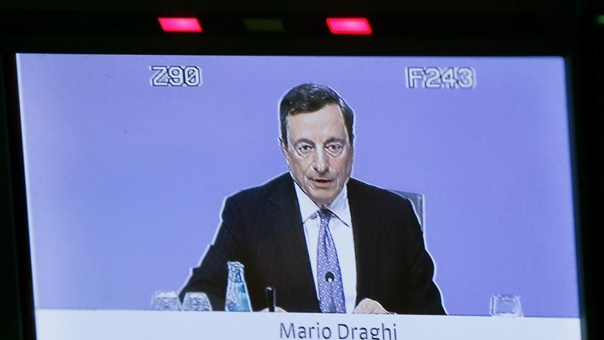 President of the European Central Bank Mario Draghi is seen speaking on a video screen during a press conference in Frankfurt, Germany, Thursday, July 21, 2016, after a meeting of the governing council. (AP Photo/Michael Probst)