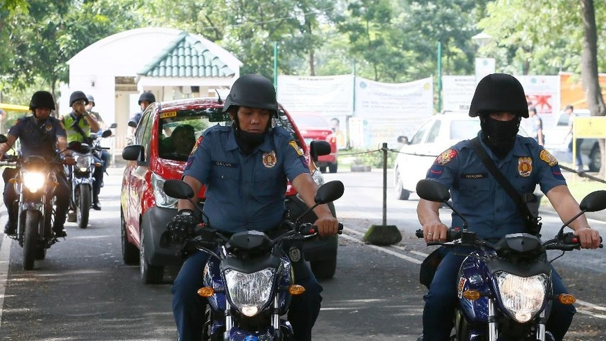 "Motorcycle-riding police officers patrol the compound of a Government hospital in the suburban Quezon city northeast of Manila, Philippines where former President Gloria Macapagal Arroyo is currently detained Wednesday, July 20, 2016. On Tuesday the Philippine Supreme Court ordered the dismissal of a plunder charge against her and ordered her immediate release from nearly five years of hospital detention. The release did not happen Wednesday due to certain ""procedural"" technicalities. (AP Photo/Bullit Marquez)"