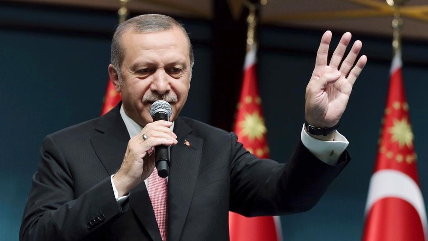 """Turkey's President Recep Tayyip Erdogan speaks after an emergency meeting of the government in Ankara, Turkey, late Wednesday, July 20, 2016. Erdogan on Wednesday declared a three-month state of emergency following a botched coup attempt, declaring he would rid the military of the """"virus"""" of subversion and giving the government sweeping powers to expand a crackdown that has already included mass arrests and the closure of hundreds of schools. (Kayhan Ozer/Pool Photo via AP)"""