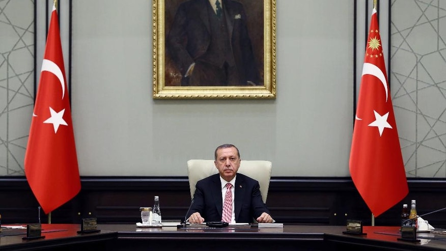 Turkey's President Recep Tayyip Erdogan heads an emergency meeting of the National Security Council in Ankara, Turkey, Wednesday, July 20, 2016. Turkey's National Security Council is holding an emergency meeting following a coup attempt last week that was derailed by security forces and protesters loyal to the government. Erdogan was heading the meeting Wednesday of the council, which is the highest advisory body on security issues. (Kayhan Ozer/Pool via AP)
