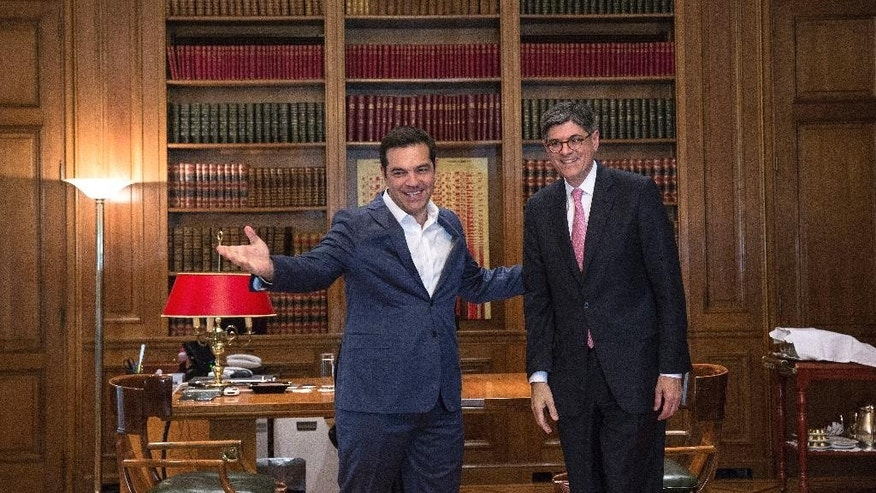 Greek Prime Minister Alexis Tsipras, left, welcomes United States Secretary of the Treasury Jacob Lew in Athens, Thursday, July 21, 2016. Lew stressed Thursday the importance of making Greece's debt sustainable, praising the country's progress in reforming its economy as part of its international bailouts but urging it to continue implementing the necessary measures. (AP Photo/Yorgos Karahalis)