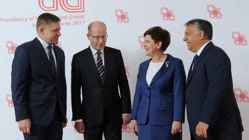 Prime Ministers of the Visegrad Group countries, Slovakia's Robert Fico, left, , Czech Republic's Bohuslav Sobotka, second left, Poland's Beata Szydlo and Hungary's Victor Orban, right, pose for a photo prior to their meeting in Warsaw, Poland, Thursday, July 21, 2016. Poland's prime minister is hosting her counterparts from the Visegrad Group of central European countries for talks on the European Union's future in the wake of Britain's decision to leave the EU. (AP Photo/Alik Keplicz)