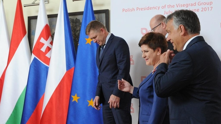 Prime Ministers of the Visegrad Group countries, Slovakia's Robert Fico, left, , Czech Republic's Bohuslav Sobotka, rear right,, Poland's Beata Szydlo and Hungary's Victor Orban, right, walk for talks in Warsaw, Poland, Thursday, July 21, 2016. Poland's prime minister is hosting her counterparts from the Visegrad Group of central European countries for talks on the European Union's future in the wake of Britain's decision to leave the EU. (AP Photo/Alik Keplicz)