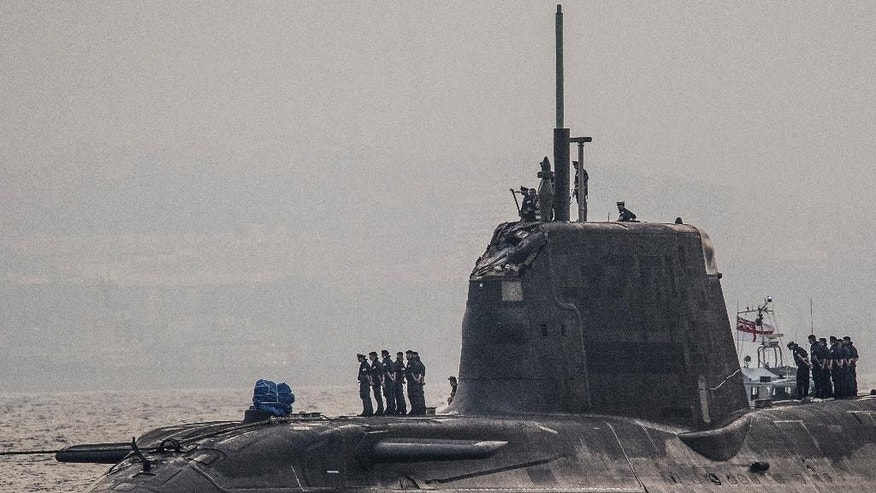 "In this Wednesday July 20, 2016, British Royal Navy submarine HMS Ambush's  arrives into the Naval Base at Gibraltar. A British Royal Navy submarine has been forced into port after colliding with a merchant vessel off the coast of Gibraltar. The navy said Wednesday that HMS Ambush's nuclear reactor was not damaged in the incident when the Astute-class submarine became ""involved in a glancing collision with a merchant vessel"" while submerged and conducting a training exercise. (AP Photo/David Parody)"