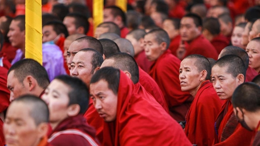 In this Thursday, July 21, 2016 photo released by Xinhua News Agency, Tibetan monks take part in the Kalachakra ritual in Xigaze, southwest China's Tibet Autonomous Region. Tibetan groups say Chinese officials have begun dismantling buildings at Larung Gar, one of the world's largest centers of Tibetan Buddhist learning. (Purbu Zhaxi/Xinhua via AP)