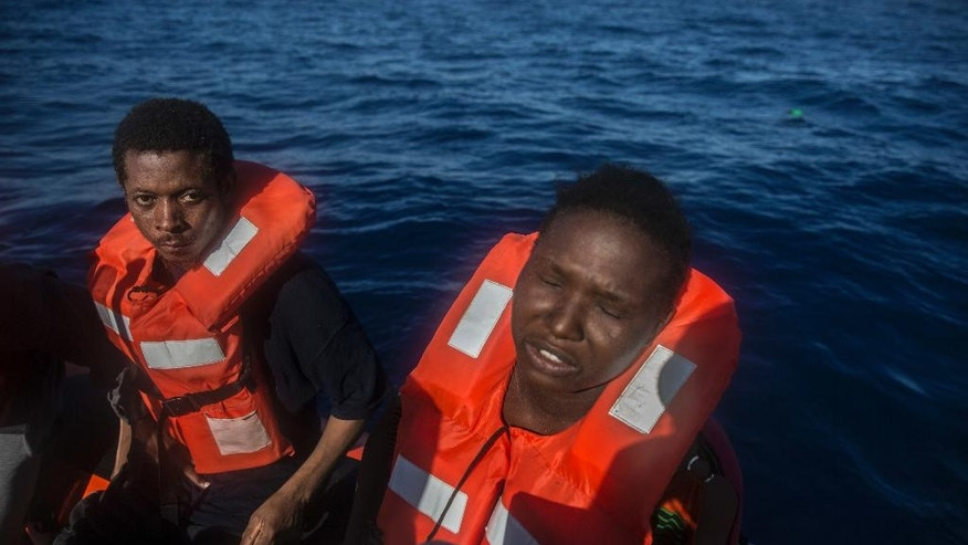 A Nigerian woman reacts onboard a boat of the Spanish NGO Proactiva Open Arms during a rescue operation on the Mediterranean sea, about 19 miles north of Az Zawiyah, Lybia, on Thursday, July 21, 2016.  Over the past weeks, vessels from NGOs, several nations' military fleets and passing cargo ships have all rescued migrants from unseaworthy boats launched from Libya's shores. (AP Photo/Santi Palacios)