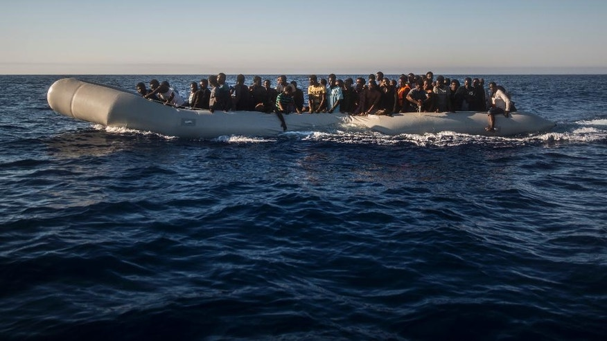 Sub-saharan refugees and migrants, mostly from Nigeria, sail aboard a partially punctured rubber boat during a rescue operation on the Mediterranean sea, about 19 miles north of Az Zawiyah, Libya, on Thursday, July 21, 2016. Over the past weeks, vessels from NGOs, several nations' military fleets and passing cargo ships have all rescued migrants from unseaworthy boats launched from Libya's shores.  (AP Photo/Santi Palacios)