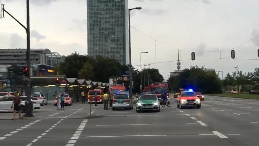 Police in Munich, Germany respond to a shooting at a shopping center in Munich, Friday July 22, 2016.  Munich police confirm shots have been fired at Olympia Einkaufszentrum shopping center but say they don't have any details about casualties. Police are responding in large numbers. (AP Photo/APTV)