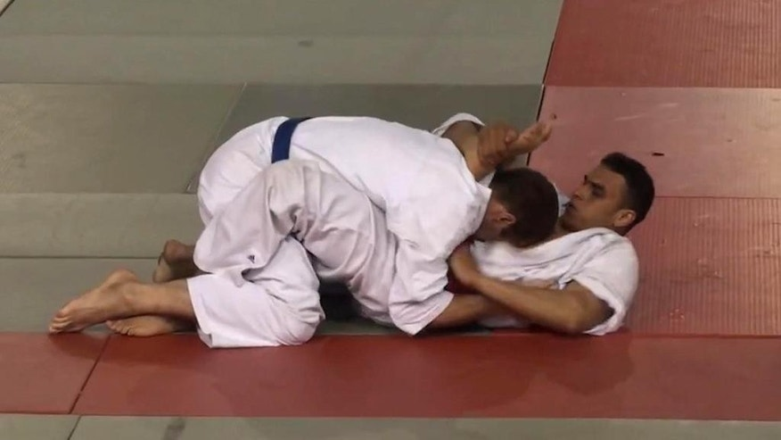 Still taken from video made available Wednesday July 20, 2016, showing Nice, France, attacker Mohamed Lahouaiej Bouhlel, right, while competing in a martial arts competition in 2010.  His opponent, who asked not to be named, said he remembers Bouhlel as an novice who repeatedly made mistakes during the fight, saying he would strike with his head and elbows which are banned by the rules. The July 14 2016, Bastille Day truck rampage by Mohamed Lahouaiej Bouhlel left at least 84 people dead. (AP Photo)