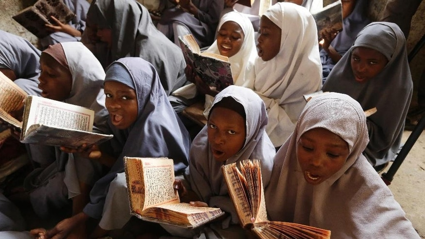 In this photo taken Wednesday April. 6, 2016 Muslim girls attend school in Kano, Nigeria. Nigerian girls have the right to wear the hijab headscarf to school, an appeals court has ruled in a country where suicide bombers have abused Islamic dress to hide their deadly weapons. (AP Photo/Sunday Alamba)