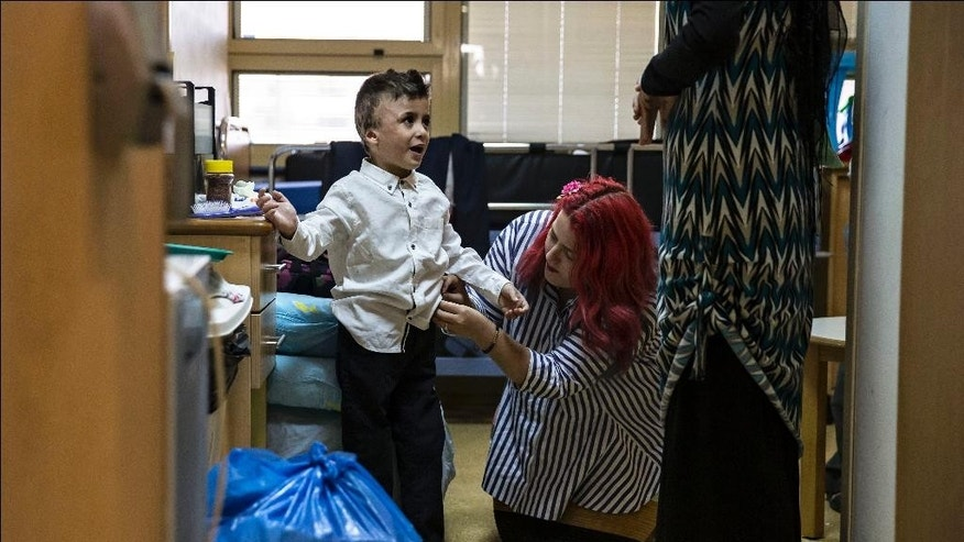 Palestinian boy Ahmad Dawabsheh, the sole survivor of a West Bank arson attack, at the Duma village is dressed at the Tel HaShomer Hospital in the city of Ramat Gan, Israel, Friday, July 22, 2016. The Palestinian boy who was seriously wounded in a firebomb attack that killed the rest of his family a year ago has been released from hospital. (AP Photo/Tsafrir Abayov)