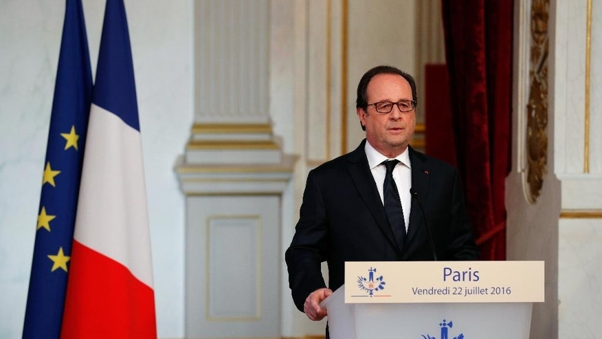 France's President Francois Hollande delivers a statement at the Elysee Palace, Friday, July 22, 2016. President Hollande says France is sending artillery equipment to Iraq as part of increased military help to fight Islamic State extremists, after a deadly attack on Nice last week claimed by IS. (AP Photo/Thibault Camus)