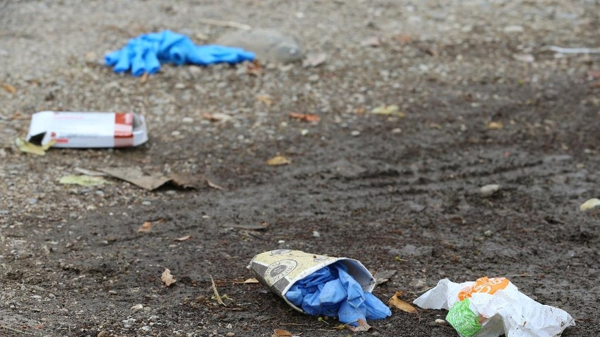 Discarded rubber gloves can be seen on the ground at the Olympia shopping centre (OEZ) one day after a shooting with deaths and casualties in Munich, Germany, Saturday, 23 July 2016. An 18-year-old fired off the deadly shoots killing ten people including himself. According to a statement by the investigators on Saturday morning, the young man of German-Iranian descent is highly likely to have acted on his own accord and killed himself afterwards Photo:(Karl-Josef Hildenbrand/dpa via AP)