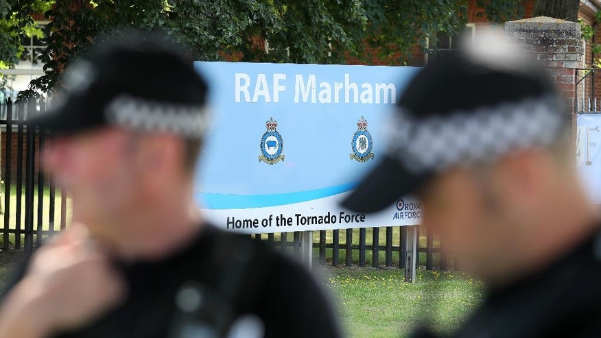 Police patrol outside RAF Marham in Norfolk, after a serviceman was threatened with a knife near to the base, in Marham, England, Thursday July 21, 2016. UK authorities say they are searching for two people in the attempted abduction of a serviceman at a Royal Air Force base in eastern England. Police said Thursday that two men, one of whom had a knife, approached the serviceman while he was jogging. One of the men shouted at the serviceman and attempted to grab him, but the serviceman fought him off and got away. ( Chris Radburn/PA via AP)