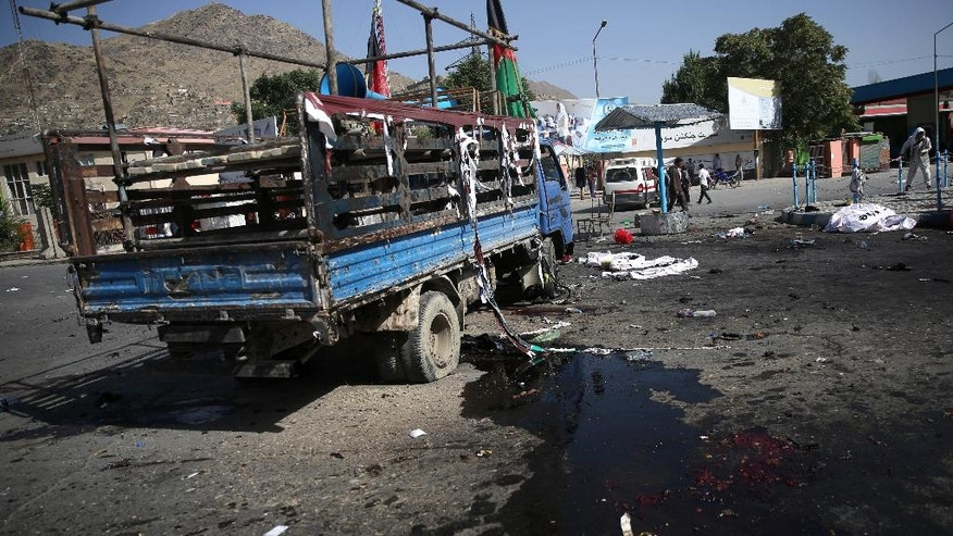 A truck, used by some leaders of a protest march, is damaged after a deadly explosion that struck a protest march by ethnic Hazaras, in Kabul, Afghanistan, Saturday, July 23, 2016. Afghan Health Ministry officials say tens of people have been killed and over 200 wounded in the bombing Saturday, that was claimed by the Islamic State group according to a statement posted on the IS-linked Aamaq online news agency. The protesters Saturday were demanding that a major regional electric power line be routed through their impoverished home province. (AP Photos/Massoud Hossaini)
