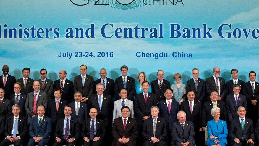 G20 Finance Ministers and Central Bank Governors pose for a group photo in Chengdu in Southwestern China's Sichuan province, Sunday, July 24, 2016. Finance Ministers and Central Bank Governors of the 20 most developed economies met in the southwestern city of Chengdu ahead of a G20 leaders meeting in September hosted by China. Participants in the front row are, from left: Britain's Chancellor of the Exchequer Philip Hammond, World Bank President Jim Yong Kim, an unidentified member, Turkey's Deputy Prime Minister Mehmet Simsek, China's Finance Minister Lou Jiwei, China's People's Bank of China Governor Zhou Xiaochuan, Germany's Federal Minister of Finance Wolfgang Schauble, International Monetary Fund Managing Director Christine Lagarde and OECD Secretary-General Angel Gurria. (AP Photo/Ng Han Guan, Pool)