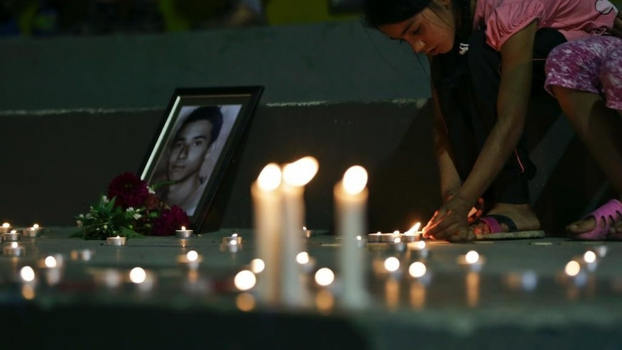 Mourners gather in Kosovo's capital Pristina on Sunday, July 24, 2016, in vigil for the victims of the Olympia shopping centre in Munich, where a shooting took place leaving nine people dead two days ago. Three ethnic Albanians, two women and a man, were among the nine people killed by a gunman in Munich. (AP Photo/Visar Kryeziu)