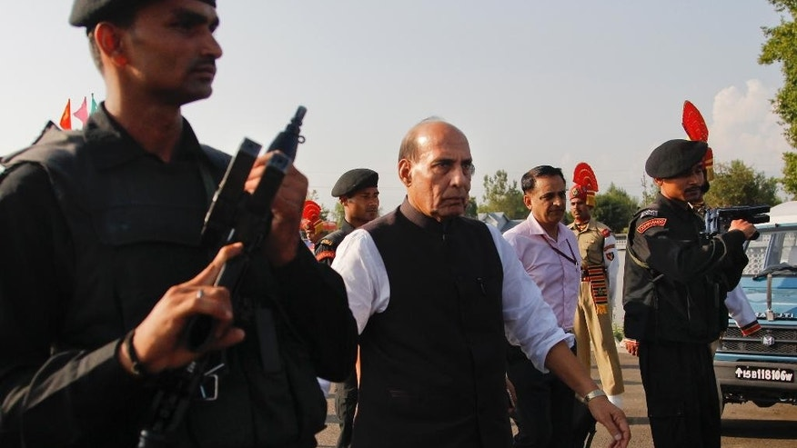 Indian Home Minister Rajnath Singh, center, arrives for a press conference in Srinagar, Indian controlled Kashmir, Sunday, July. 24, 2016. Singh visited Kashmir over the weekend, following street battles between government forces and protesters in the region.(AP Photo/Mukhtar Khan)