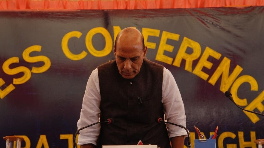 Indian Home Minister Rajnath Singh, arrives for a press conference in Srinagar, Indian controlled Kashmir, Sunday, July. 24, 2016. Singh visited Kashmir over the weekend, following street battles between government forces and protesters in the region. (AP Photo/Mukhtar Khan)