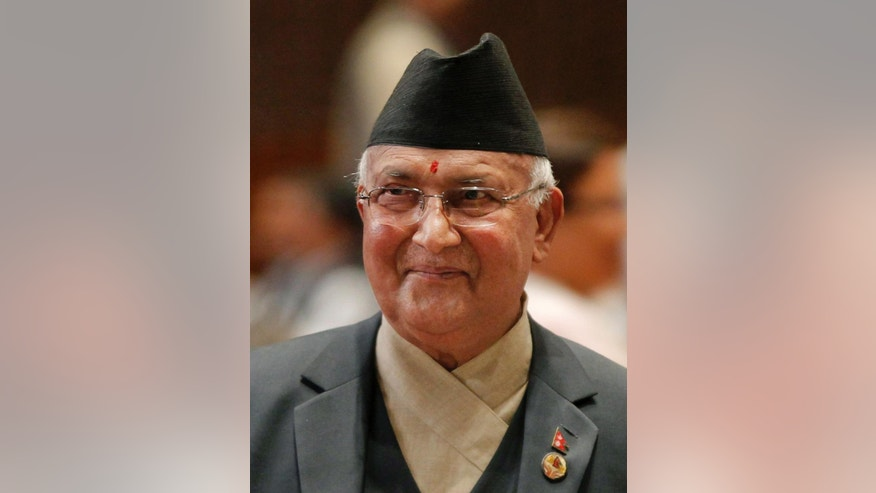 FILE- In this Oct. 11, 2015 file photo, Nepal's Khadga Prasad Oli smiles as he addresses the parliament before being appointed as the new Prime Minister in Kathmandu, Nepal. Oli has resigned before facing a confidence vote in parliament that he expected to lose. (AP Photo/Niranjan Shrestha, File)