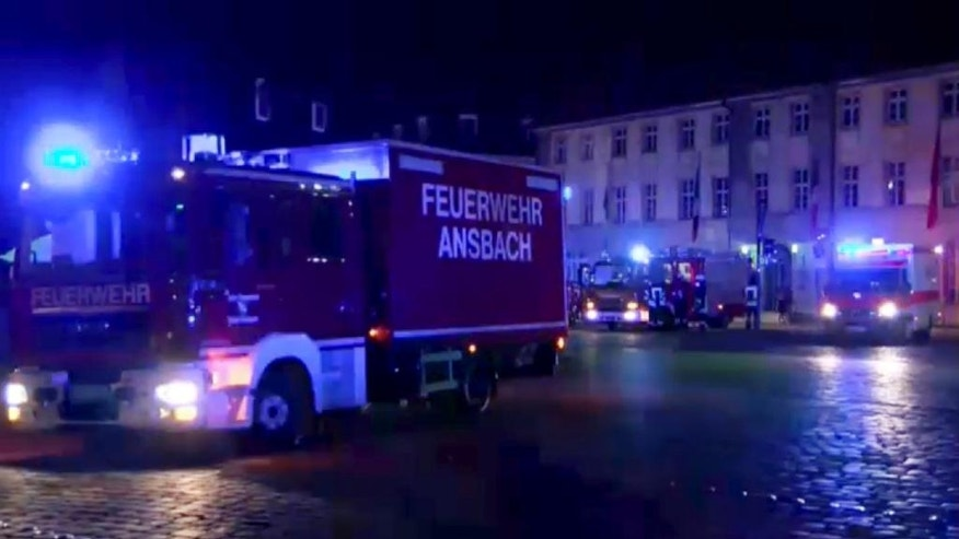 GERMANY OUT - In this image taken from video fire trucks and ambulances stand in the city center of Ansbach near Nuremberg, southern Germany, Monday morning, July 25, 2016, after a man was killed when an explosive device he was believed to be carrying went off near an open-air music festival, injuring 10 others. (News5 via AP)