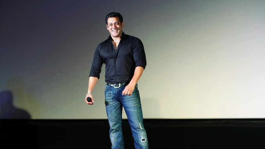 FILE- In this July 15, 2015 file photo, Indian Bollywood actor Salman Khan smiles as he attends the trailer launch of his upcoming movie 'Hero' in Mumbai, India. A court in western India has on Monday, July 25, 2016 acquitted Khan of shooting and killing three endangered animals nearly two decades ago. (AP Photo/Rajanish Kakade, File)
