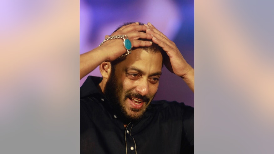 FILE- In this Nov. 11, 2015 file photo, Bollywood actor Salman Khan attends a promotional event for his upcoming movie 'Prem Ratan Dhan Payo' in Mumbai, India. A court in western India has on Monday, July 25, 2016 acquitted Khan of shooting and killing three endangered animals nearly two decades ago.(AP Photo/Rafiq Maqbool, File)