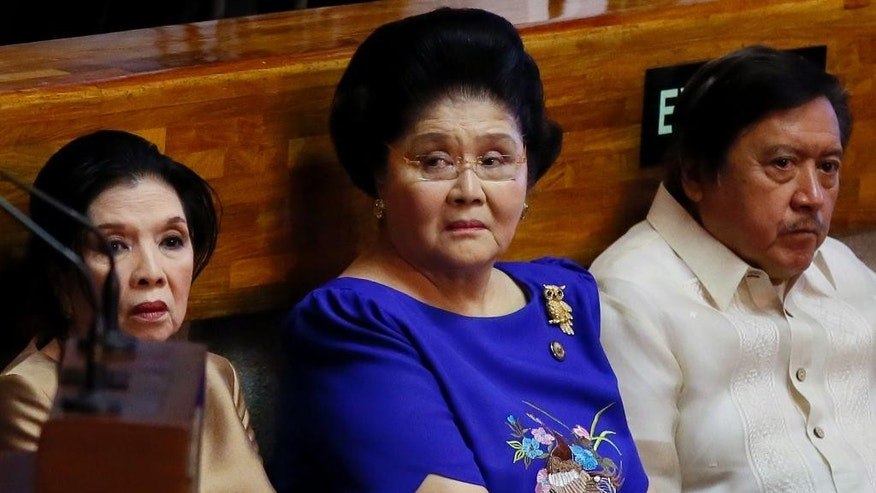 Former Philippine First Lady and now Congresswoman Imelda Marcos, center, sits with fellow lawmakers as she attends the opening session of the 17th Congress wherein President Rodrigo Duterte is to deliver his state of the nation address Monday, July 25, 2016 , at suburban Quezon city northeast of Manila, Philippines. (AP Photo/Bullit Marquez)