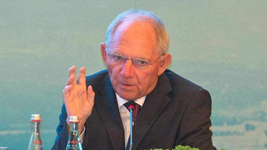 Germany's Federal Minister of Finance Wolfgang Schauble speaks on stage at the High-level Tax Symposium held in Chengdu in Southwestern China's Sichuan province, Saturday, July 23, 2016. Finance ministers and Central Bank governors of the 20 most developed economies are to meet in the southwestern city of Chengdu ahead of a G20 leaders meeting in September hosted by China. (AP Photo/Ng Han Guan, Pool)