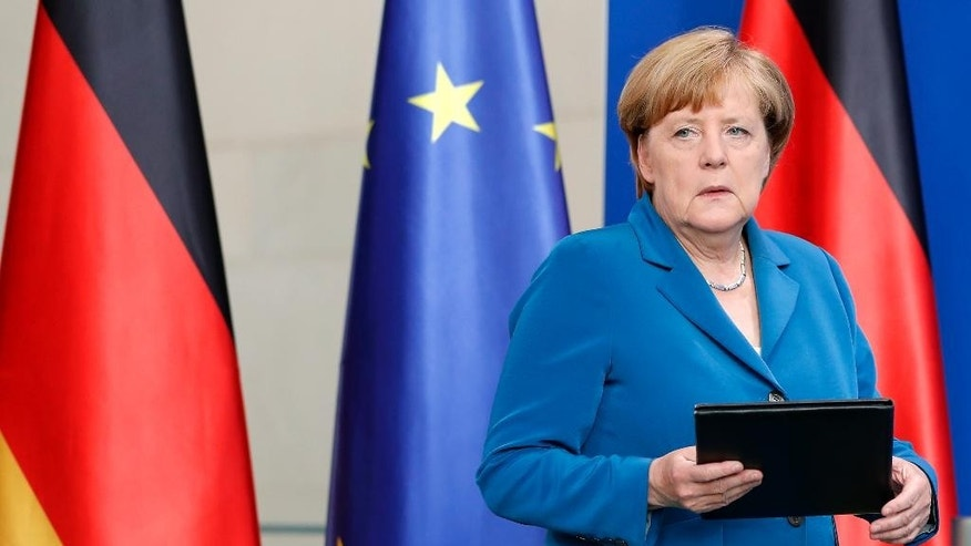 FILE- In this Saturday, July 23, 2016 file photo, German Chancellor Angela Merkel arrives for a statement in Berlin, Germany, on the Munich attack. Four attacks in a week — three of them carried out by asylum seekers — have left Germany on edge and Chancellor Angela Merkel's policies of welcoming refugees under renewed criticism. Anxiety over Germany's ability to cope with last year's flood of more than 1 million registered asylum seekers first surged following a series of sexual assaults and robberies in Cologne during New Year celebrations.  (AP Photo/Michael Sohn, File)