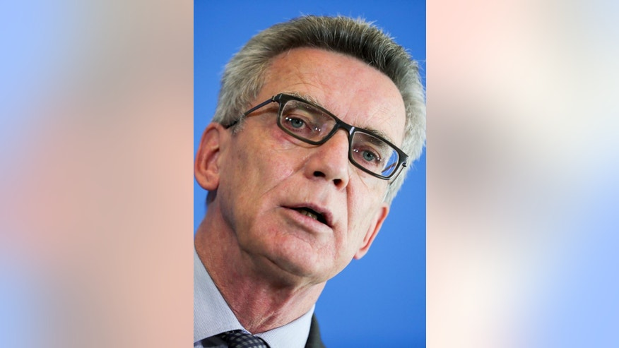 German Interior Minister Thomas de Maiziere speaks during a news conference in Berlin, Germany, Monday, July 25, 2016. De Maiziere said he has ordered increased security presence at airports, train stations and elsewhere in the wake of a series of attacks. (Michael Kappeler/dpa via AP)