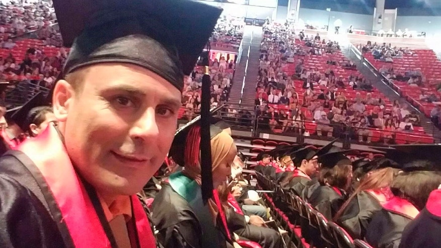 In this May 2016 photo released by a family member shows Robin Shahini during his International Security and Conflict Resolution San Diego State University graduation ceremony in San Diego, Calif. T
