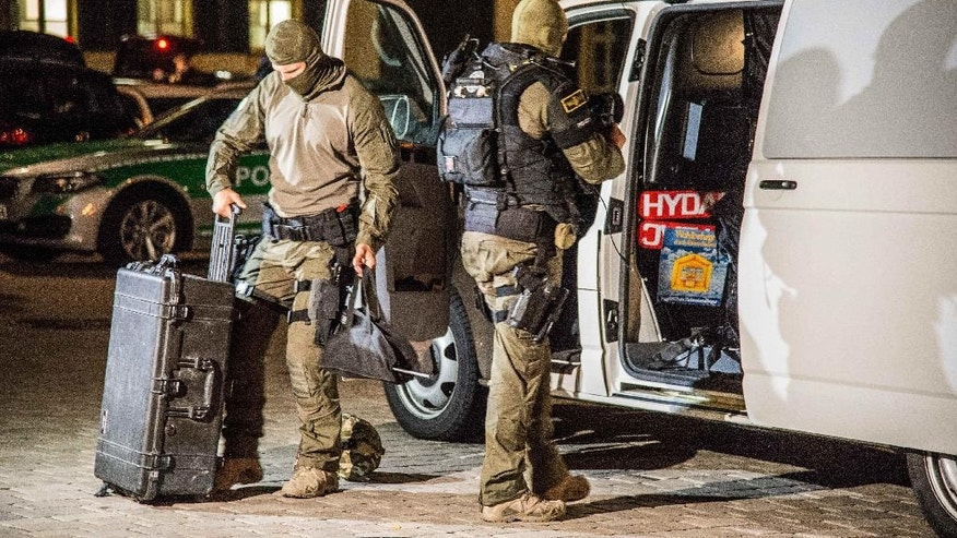 Special police officers arrive at the scene after an explosion occurred in Ansbach, Germany, Monday, July 25, 2016. Bavaria's top security official says a man who blew himself up after being turned away from an open-air music festival in the southern German city was a 27-year-old Syrian who had been denied asylum. (Friebe/dpa via AP)