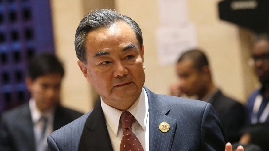 Chinese Foreign Minister Wang Yi arrives to attend the meeting Association of Southeast Asian Nations (ASEAN) –China Foreign Ministers' Meeting in Vientiane, Laos, Monday, July 25, 2016. A highly anticipated meeting between Southeast Asian foreign ministers and their Chinese counterpart Wang Yi has begun in what is expected to be tense discussions on China's territorial expansion in the South China Sea.  (AP Photo/Sakchai Lalit)