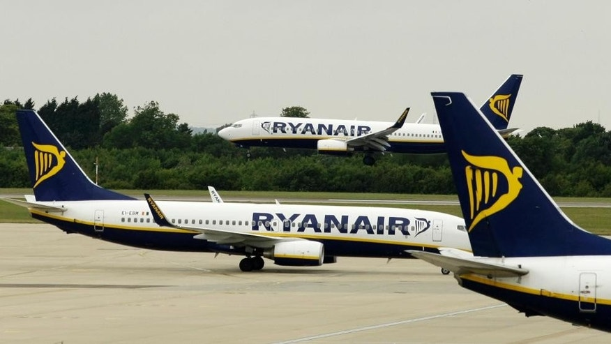 FILE- In this Tuesday July 21, 2009 file photo, Ryanair planes are seen at Stansted Airport in England. Ryanair said Monday, July 25, 2016 it will reduce winter services at its main London hub and focus on other European bases because of weakened British growth and consumer sentiment following Britain's vote to leave the EU.  (AP Photo/Matt Dunham, File).