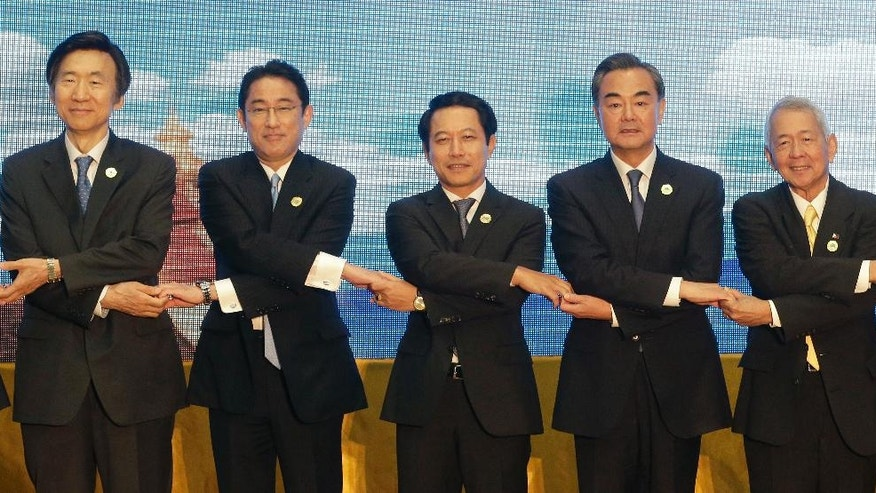 From left to right; South Korea's Foreign Minister Yun Byung-se, Japan's Foreign Minister Fumio Kishida, Laos Foreign Minister Saleumxay Kommasith, China's Foreign Minister Wang Yi, Philippines' Foreign Minister Perfecto Yassay as they pose for a photo during the Association of Southeast Asian Nations (ASEAN) Foreign Ministers' Meeting in Vientiane, Laos, Tuesday, July 26, 2016. (AP Photo/Sakchai Lalit)