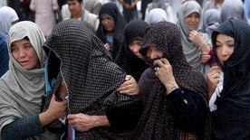 Afghan women mourn during the funeral of victims who died from a suicide attack, in Kabul, Afghanistan, Sunday, July 24, 2016. Afghanistan held a national day of mourning on Sunday, a day after a suicide bomber killed at least 80 people who were taking part in a peaceful demonstration in Kabul. The attack was claimed by the Islamic State group. (AP Photos/Massoud Hossaini)