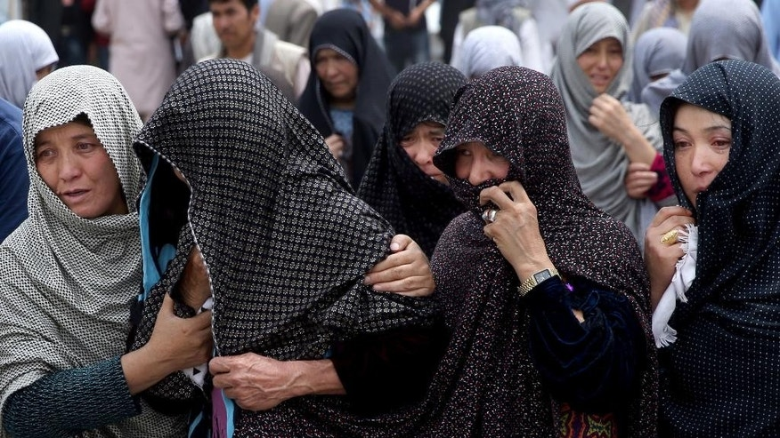 Afghan women mourn during the funeral of victims who died from a suicide attack in Kabul on Sunday.