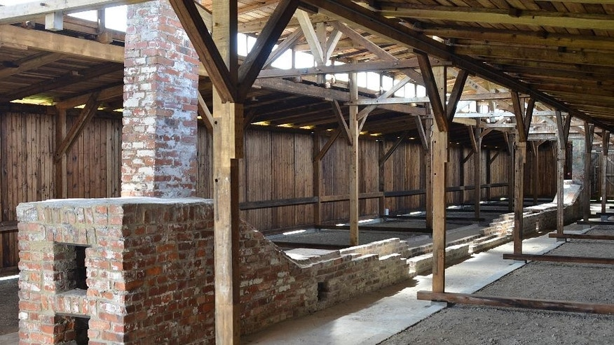 This image made available by he Auschwitz-Birkenau State Museum  taken  July 22, 2016 shows barracks at the former Nazi German death camp of Auschwitz-Birkenau after a recent restoration.Half of the barracks were on display for more than 20 years at the United States Holocaust Memorial Museum in Washington D.C., but were returned to Poland in 2013. Conservation work was finished in July and study groups will be able to start visiting the barracks in August. (Auschwitz-Birkenau State Museum via AP)