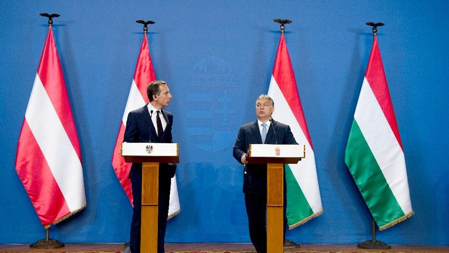Austrian Chancelor Christian Kern, left, and Hungarian Prime Minister Viktor Orban hold a joint press conference at the Delegation Room of the Parliament in Budapest, Hungary, Tuesday, July 26, 2016. (Szilard Koszticsak/MTI via AP)