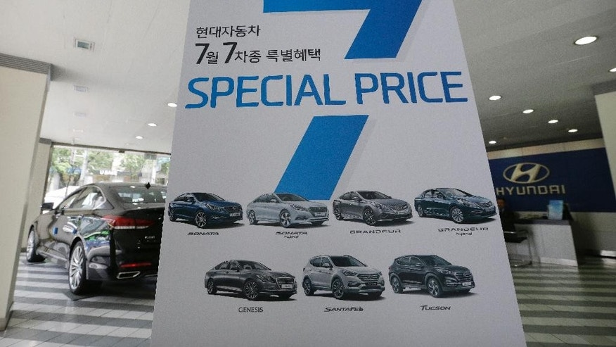 A banner advertising Hyundai Motor Co.'s vehicles is displayed at the company's showroom in Seoul, South Korea, Tuesday, July 26, 2016. Hyundai Motor Co. says its second-quarter income fell from a year earlier for a tenth straight quarter. (AP Photo/Ahn Young-joon)