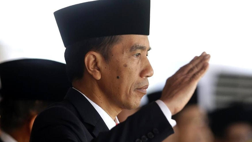 "FILE - In this Aug. 17, 2015, file photo, Indonesia's President Joko Widodo salutes during a flag raising ceremony for Independence Day at Merdeka Palace in Jakarta, Indonesia. Indonesia has beefed up security at Nusa Kambangan prison island and closed it to visitors in a sign authorities will execute people convicted of drug crimes for the third time since President Joko ""Jokowi"" Widodo was elected in 2014. (AP Photo/Achmad Ibrahim)"