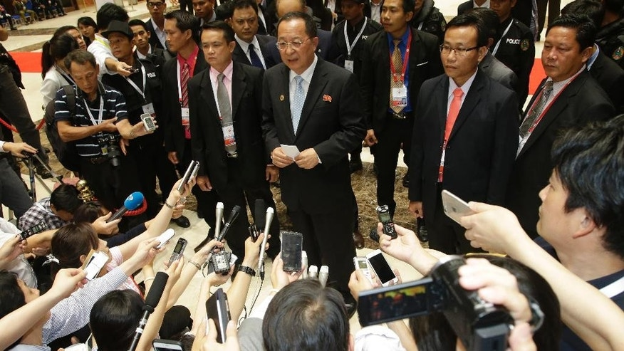 North Korea Foreign Minister Ri Yong Ho talks to reporters after a break during the 23rd Asean Regional meeting in Vientiane, Laos, Tuesday, July 26, 2016. (AP Photo/Sakchai Lalit)