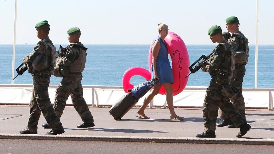 FILE - This Wednesday, July 20, 2016 file picture shows soldiers patrolling the famed Promenade des Anglais in Nice, southern France. Since January 2015, IS-inspired attackers have killed at least 235 people in France, by far the largest casualty rate of any Western country. (AP Photo/Claude Paris, File)