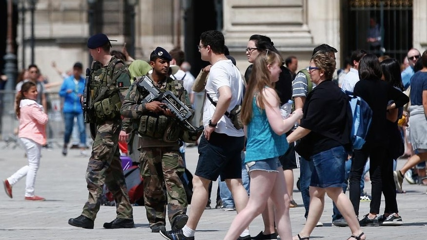 FILE - This Friday, July 15, 2016 file photo shows soldiers on patrol around the Louvre museum in Paris, France. Since January 2015, IS-inspired attackers have killed at least 235 people in France, by far the largest casualty rate of any Western country. (AP Photo/Thibault Camus, File)