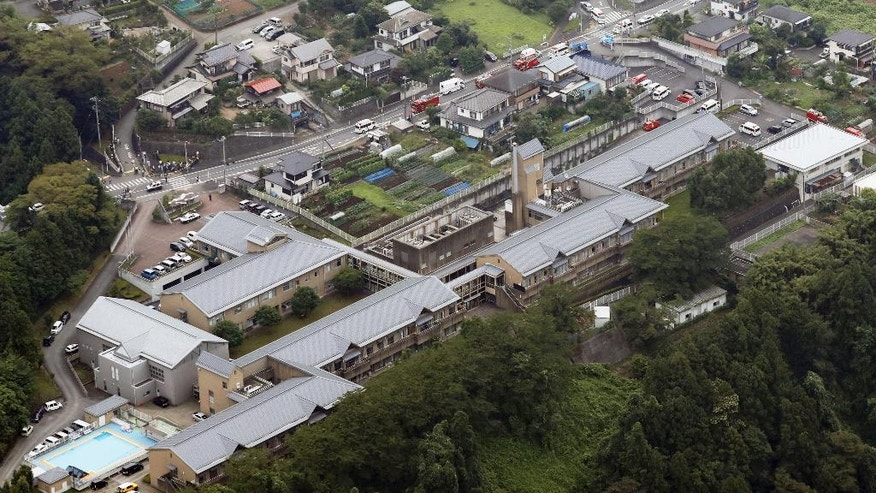 This aerial view shows  Tsukui Yamayuri-en, a facility for the handicapped where a number of people were killed and dozens injured in a knife attack Tuesday, July 26, 2016,  in Sagamihara, outside Tokyo. (Kyodo News via AP)