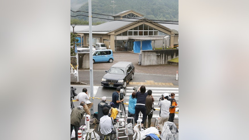 A hearse leaves the Tsukui Yamayuri-en, a facility for the mentally disabled where a number of people were killed and dozens injured in a knife attack Tuesday, July 26, 2016, in Sagamihara, outside Tokyo. A young Japanese man went on a stabbing rampage early Tuesday at the facility where he had been fired, officials said, killing many people months after he gave a letter to Parliament outlining the bloody plan and saying all disabled people should be put to death. (Kazushige Fujikake/Kyodo News via AP)  JAPAN OUT, MANDATORY CREDIT